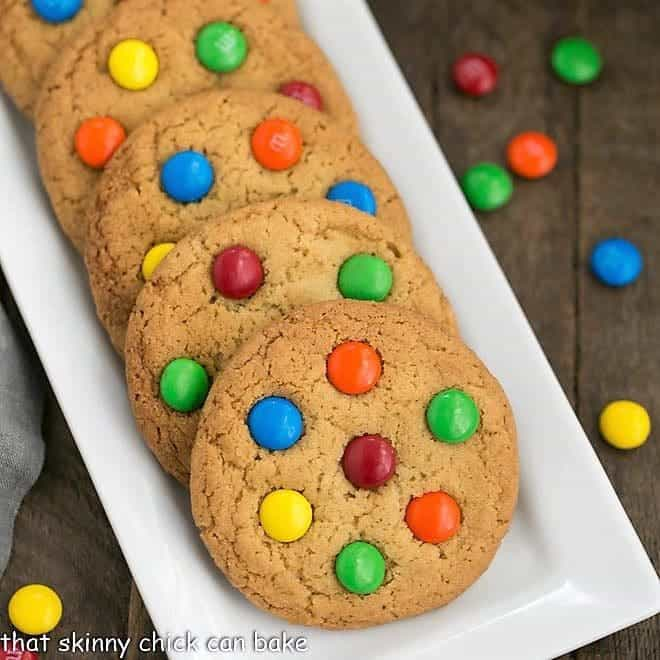 Classic M & M Cookies on a white ceramic tray
