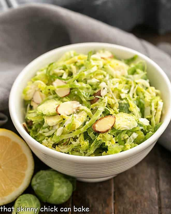 Shaved Brussels Sprouts Salad in a small white salad bowl