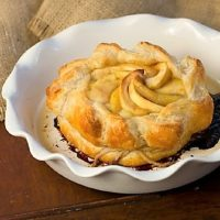 Apple Baked Brie in a white baking dish