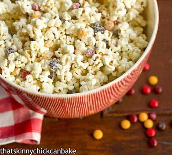 Holiday White Chocolate Popcorn in a red and white serivng bowl Perfect for gifting and/or snacking!