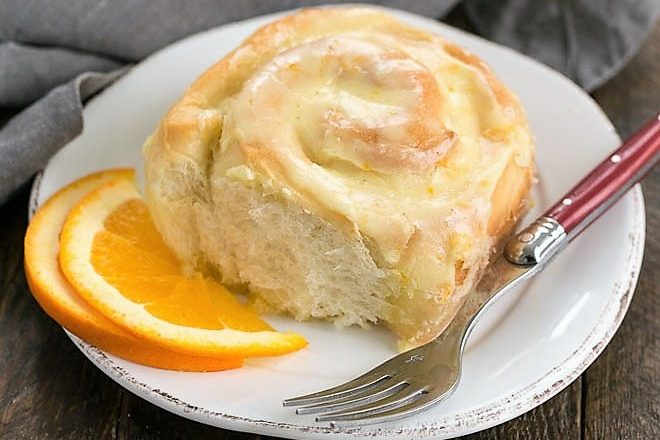 Orange sweet roll on a white plate