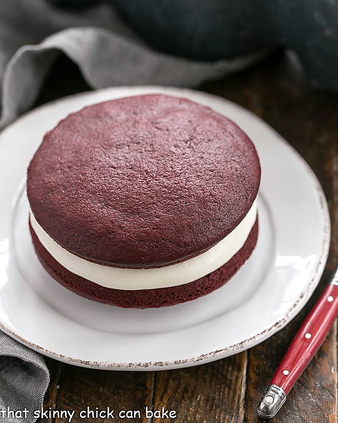 Red velvet whoopie pie on a round white plate
