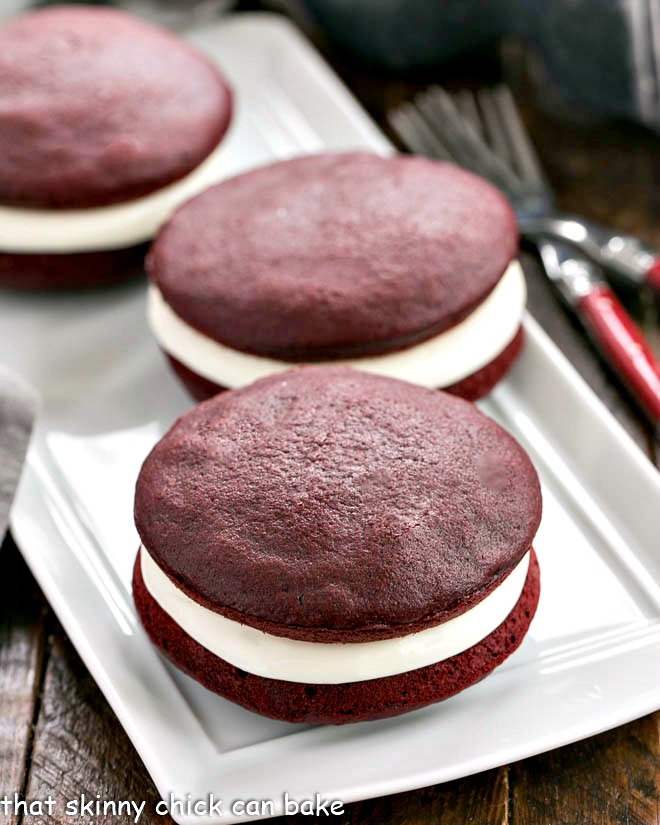 Red velvet whoopie pies on a white serving tray