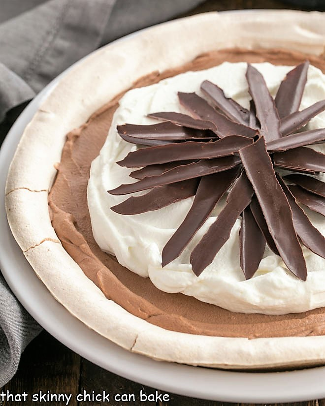 Close up of Chocolate Angel Pie in a white ceramic pie plate