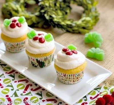 Holly Topped White Cupcakes on a white rectangular platter