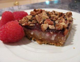 Raspberry Magic cookie bar on a white plate