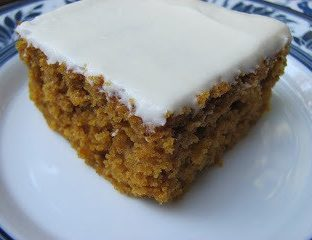 A piece of carrot cake on a plate