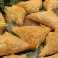 Chicken Samosas on a leaf lined platter