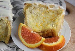 A close up of orange pull apart coffee cake