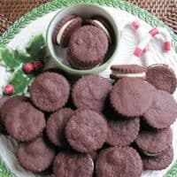Overhead view of chocolate sandwich cookies on a holiday platter