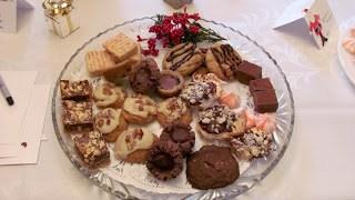 A glass plate of mini desserts