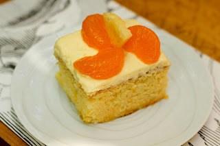 Mandarin Orange Cake AKA Pea Pickin' Cake slice on a white plate