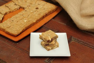 Stack of chocolate chunk bars on a square white plate