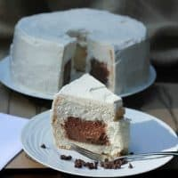 Slice of Mousse Filled Angel Food Cake in front of rest of cake on a plate