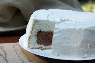 Side view of Mousse Filled Angel Food Cake with a slice removed