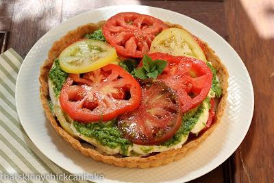Fresh tomato tart on a white plate