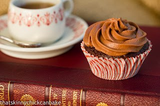 Classic Chocolate Cupcakes with Chocolate Buttercream on a stack of books