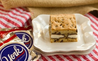 A peppermint stuffed chocolate chip cookie bar on a stack of plates