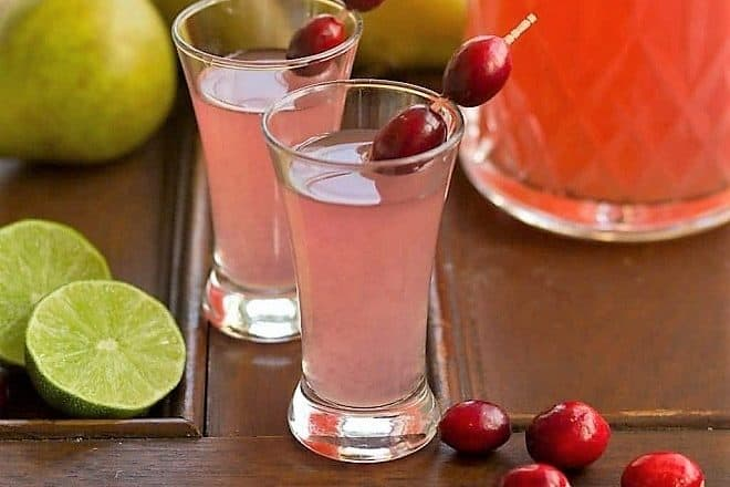 Pear Cosmopolitans in small glasses garnished with fresh cranberries