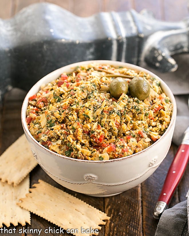 Roasted Red Pepper Artichoke Tapenade in a white serving bowl