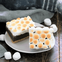 2 s'mores brownies on an oval white plate
