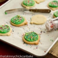 Sugar cookies on a baking sheet with sprinkles