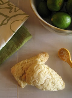 Key Lime White Chocolate Scones next to a bowl of limes