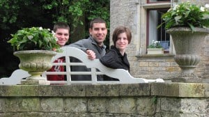 My 3 children on a bench in Normandy, France