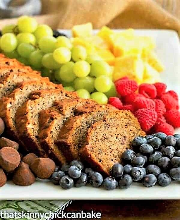 Tray of sliced Nutty Brown Butter Banana Bread with fruit