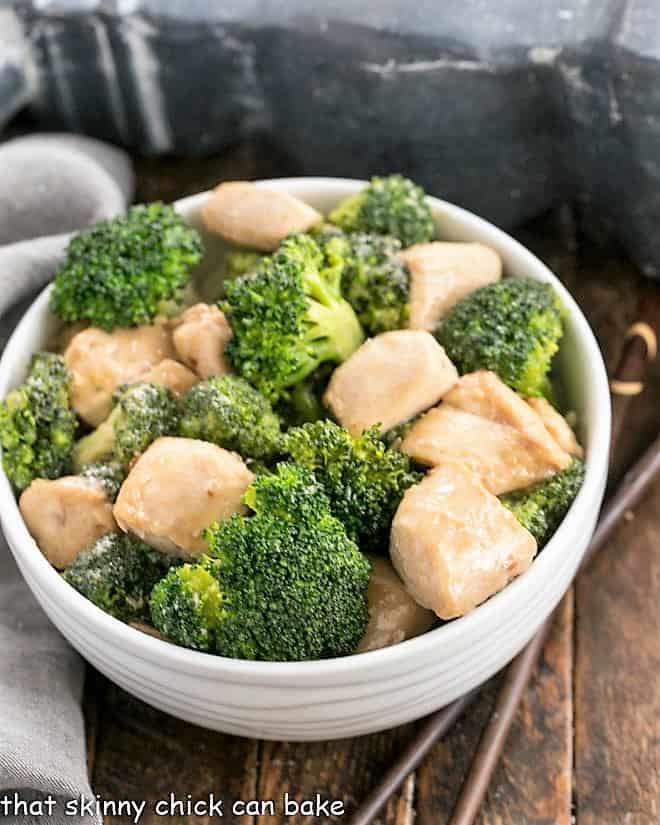 Overhead view of broccoli chicken in a white ceramic bowl