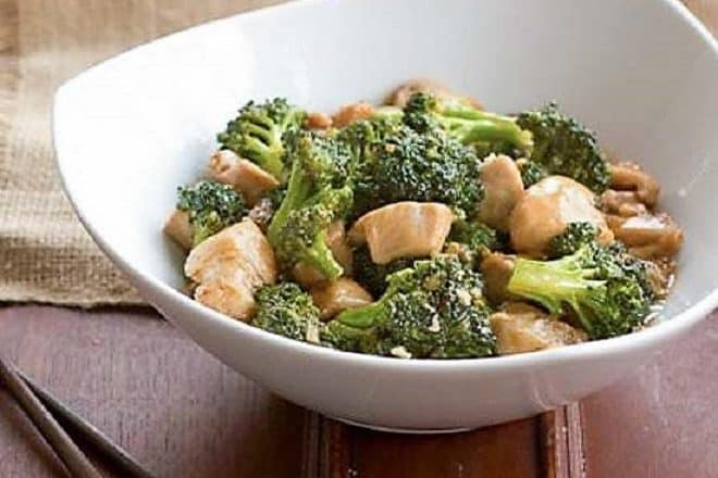 Chicken and Broccoli Stir Fry in a white ceramic bowl
