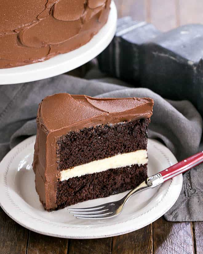 Slice of chocolate layer cake with a white chocolate ganache filling