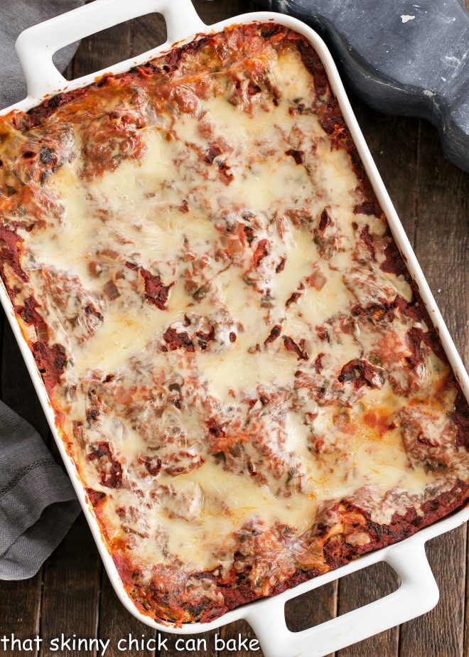 Overhead view of Spinach Lasagna in a white casserole dish