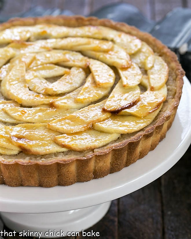 French Apple tart on a white cake stand
