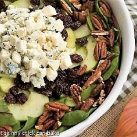 Overhead view of Loaded Winter Salad with Apples, Pecans, Blue Cheese and Dried Cherries