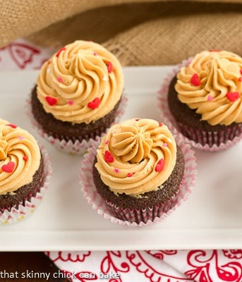 Overhead view of frosted chocolate cupcakes on a white tray
