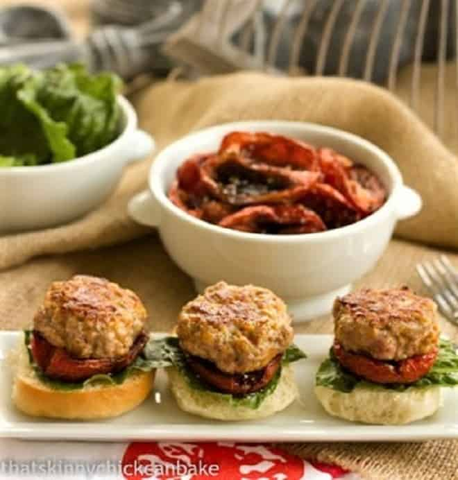 Turkey Sliders with Roasted Tomatoes lined up on a white serving tray