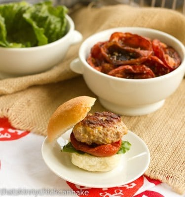 A Turkey Sliders with Roasted Tomatoes on a round white plate