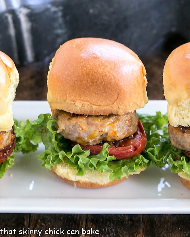 Line of turkey sliders on a white serving tray