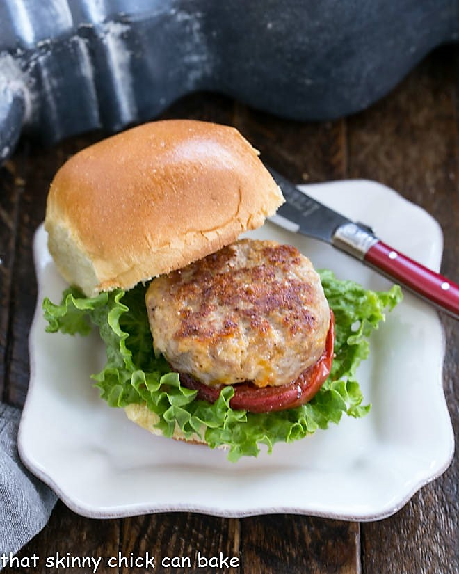 A Turkey Slider with Roasted Tomatoes on a square white plate