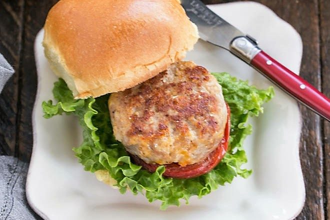 Overhead view of mini turkey burger on a square white plate