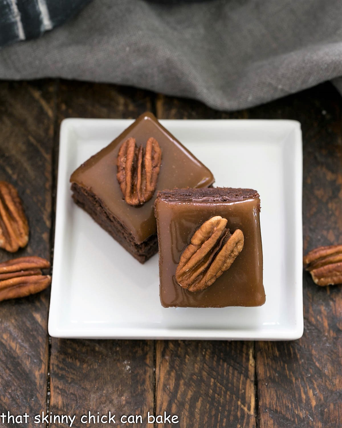 2 turtle brownies on a square white plate
