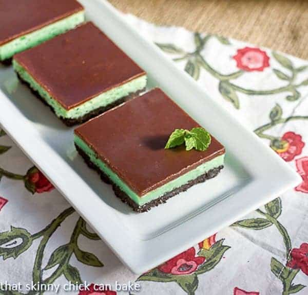 Grasshopper Cheesecake Bars on a white rectangular tray