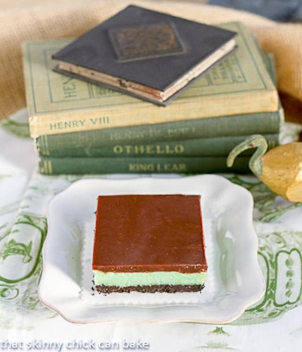Grasshopper Cheesecake Bar on a white dessert plate on a green and white napkin