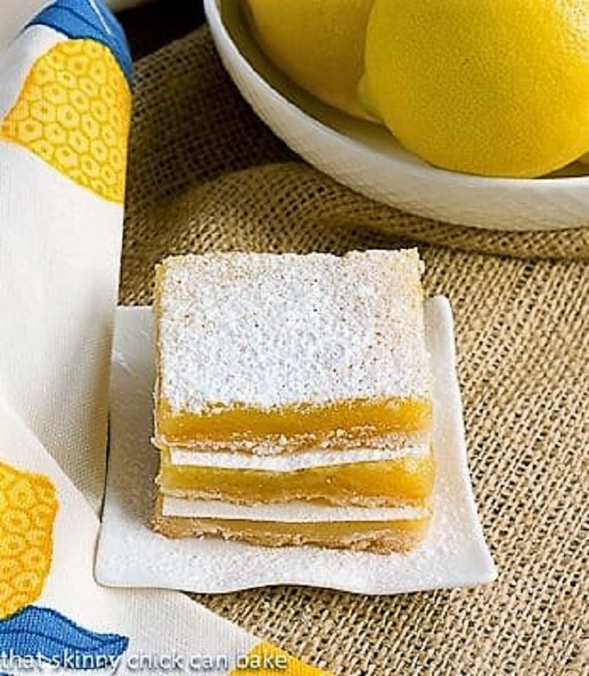 Easy lemon squares stacked on a square white plate