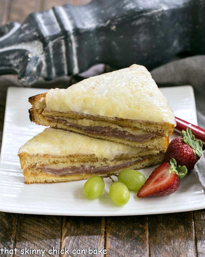 French Ham and Cheese Sandwich stacked on a square white plate