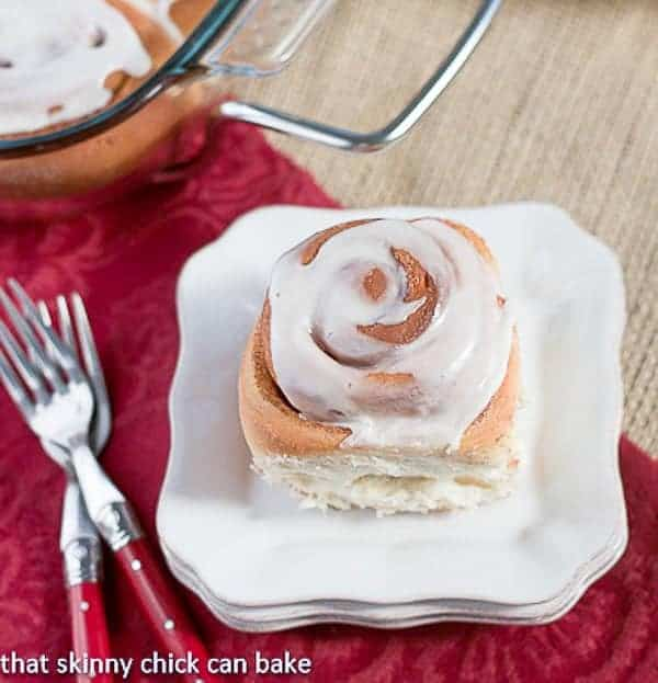 Moomie's Cinnamon Buns on a stack of white plates