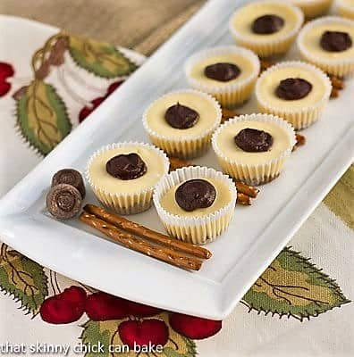 Mini Rolo Cheesecakes with Pretzel Crusts on a white tray