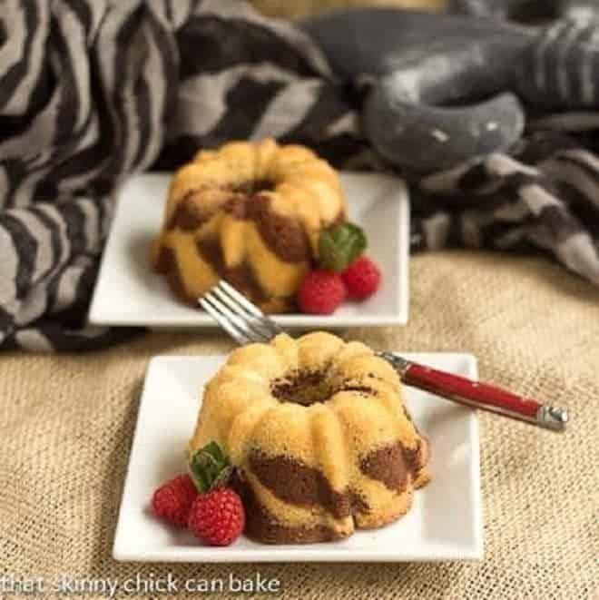 Two Mini Zebra Bundt Cakes on square white dessert plates