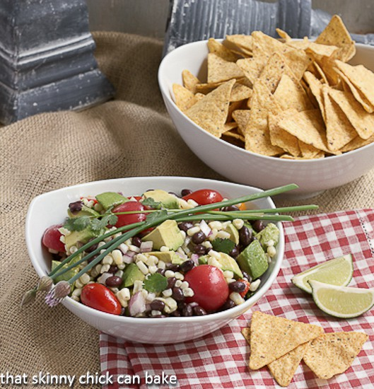 Black Bean Avocado Salsa in a white bowl with chips